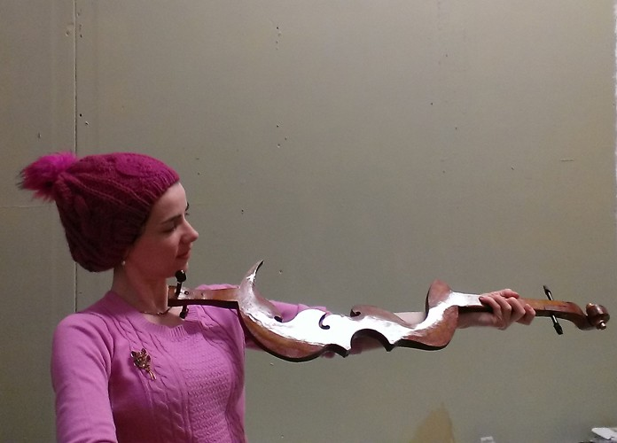 Méadhbh O'Connor holding a french polished strut.